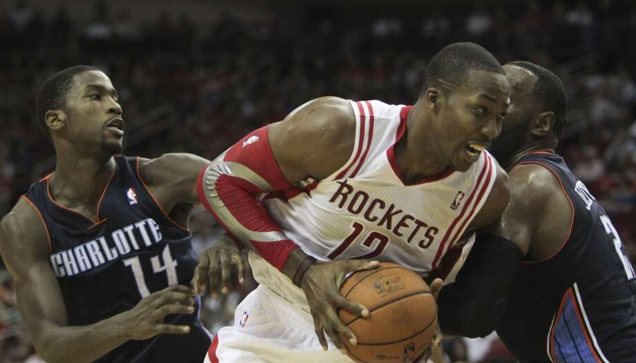 Rockets center Dwight Howard drives against the Bobcats. Photo: James Nielsen, Houston Chronicle