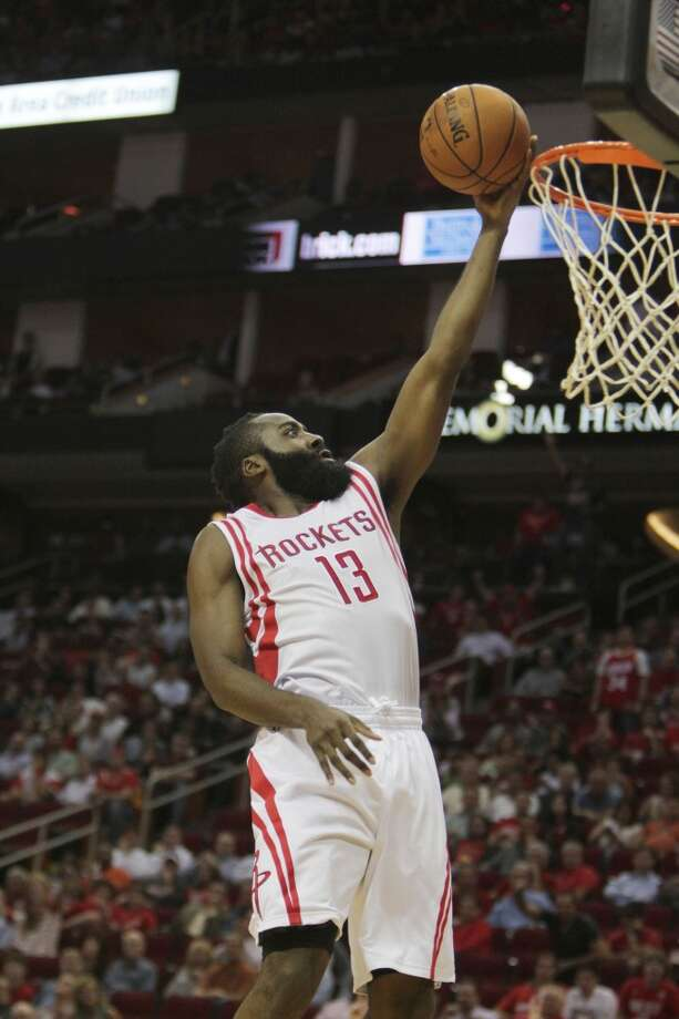 Rockets shooting guard James Harden gets an easy two points against the Bobcats. Photo: James Nielsen, Houston Chronicle