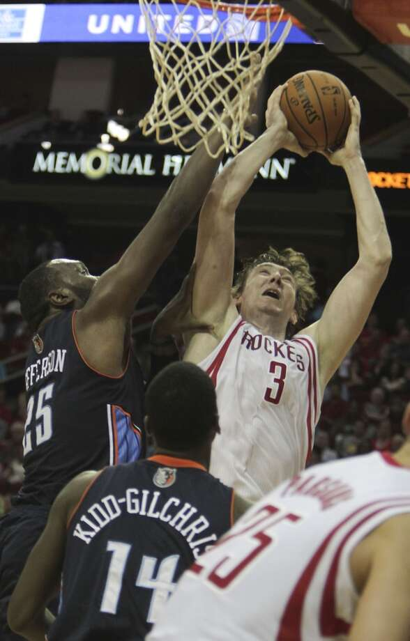 Omer Asik of the Rockets attempts a shot against the Bobcats. Photo: James Nielsen, Houston Chronicle