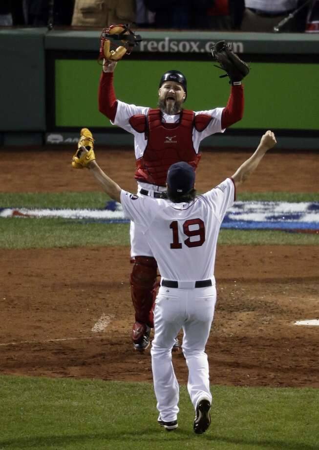 Red Sox relief pitcher Koji Uehara (19) and catcher David Ross celebrate after Boston defeated the Cardinals in Game 6. Photo: Charlie Riedel, Associated Press