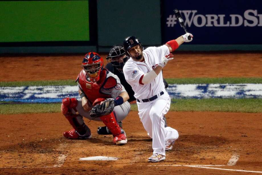 Shane Victorino #18 of the Red Sox hits a three run double in the third inning. Photo: Jim Rogash, Getty Images