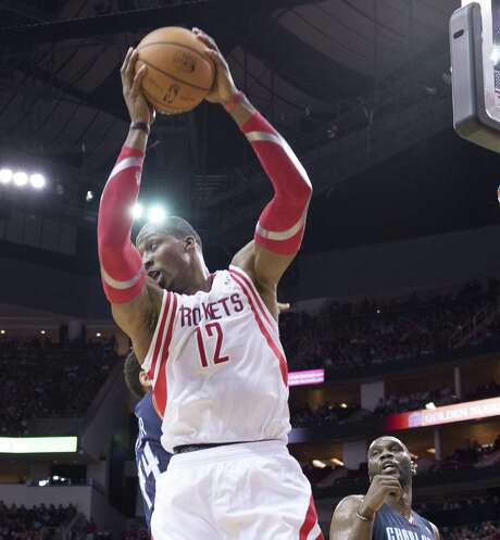 Houston center Dwight Howard pulls in one of his 26 rebounds in his Rockets debut against Charlotte. He also had 17 points, two blocks and two assists. Photo: George Bridges / McClatchy-Tribune News Service