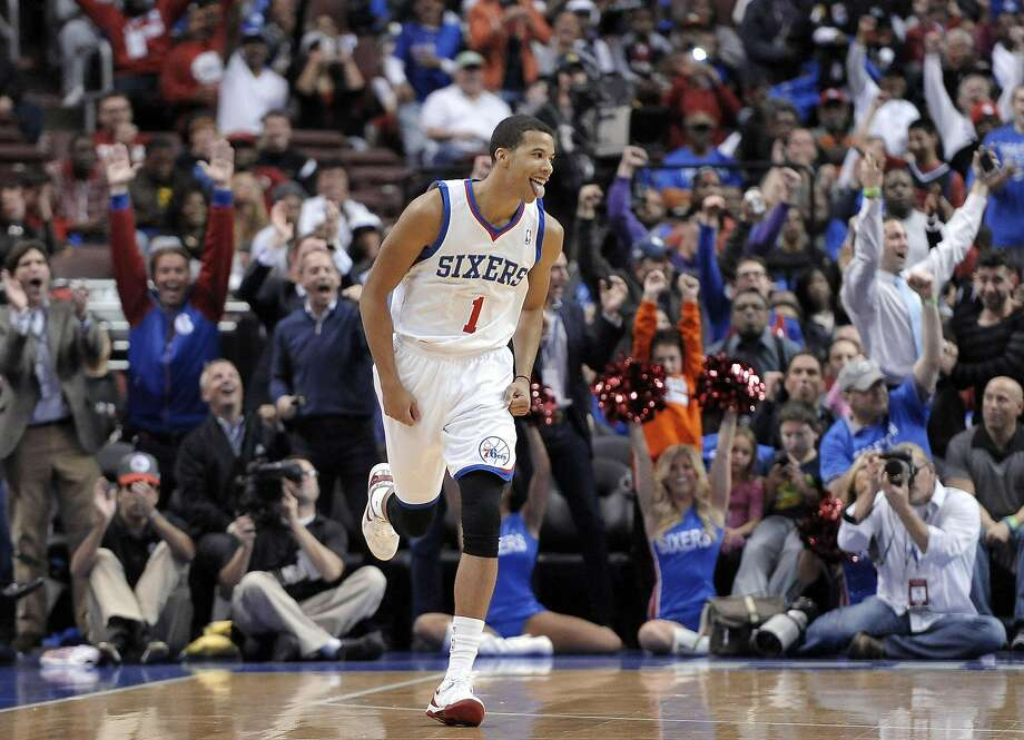 Philadelphia 76ers' Michael Carter-Williams (1) celebrates after making a 3-point basket during the first half of an NBA basketball game against the Miami Heat, Wednesday, Oct. 30, 2013, in Philadelphia. The 76ers won 114-110. (AP Photo/Michael Perez) Photo: Michael Perez, Associated Press