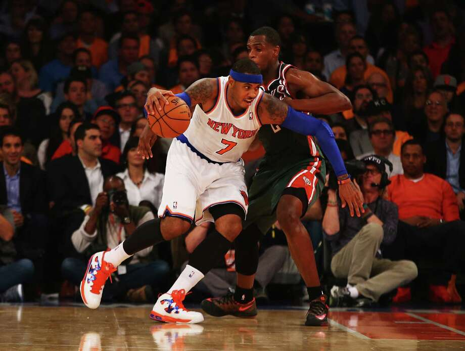 NEW YORK, NY - OCTOBER 30:  Carmelo Anthony #7 of the New York Knicks drives against Khris Middleton #22 of the Milwaukee Bucks during their game at Madison Square Garden on October 30, 2013 in New York City.  NOTE TO USER: User expressly acknowledges and agrees that, by downloading and or using this Photograph, user is consenting to the terms and conditions of the Getty Images License Agreement. Mandatory Copyright Notice.  (Photo by Al Bello/Getty Images) ORG XMIT: 182407335 Photo: Al Bello / 2013 Getty Images