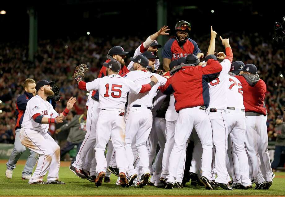 BOSTON, MA - OCTOBER 30:  The Boston Red Sox celebrate after defeating the St. Louis Cardinals in Game Six of the 2013 World Series at Fenway Park on October 30, 2013 in Boston, Massachusetts. The Boston Red Sox defeated the St. Louis Cardinals 6-1.  (Photo by Rob Carr/Getty Images) ORG XMIT: 185688241 Photo: Rob Carr / 2013 Getty Images