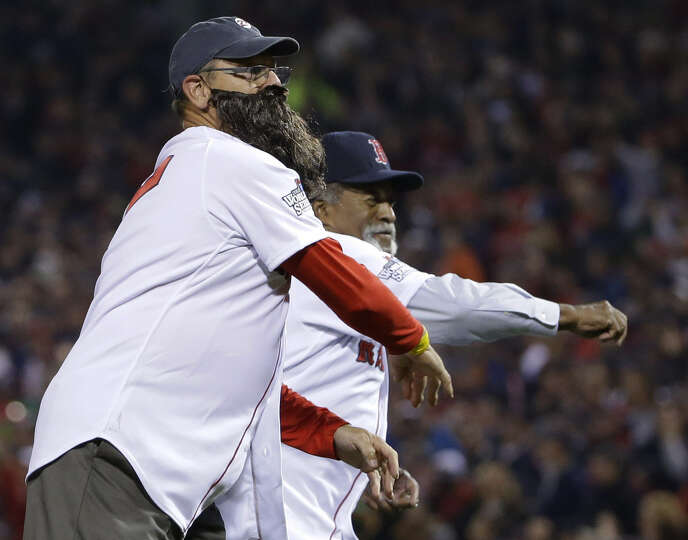 Carlton Fisk (left) dons a fake beard while throwing out the first pitch with Luis Tiant.