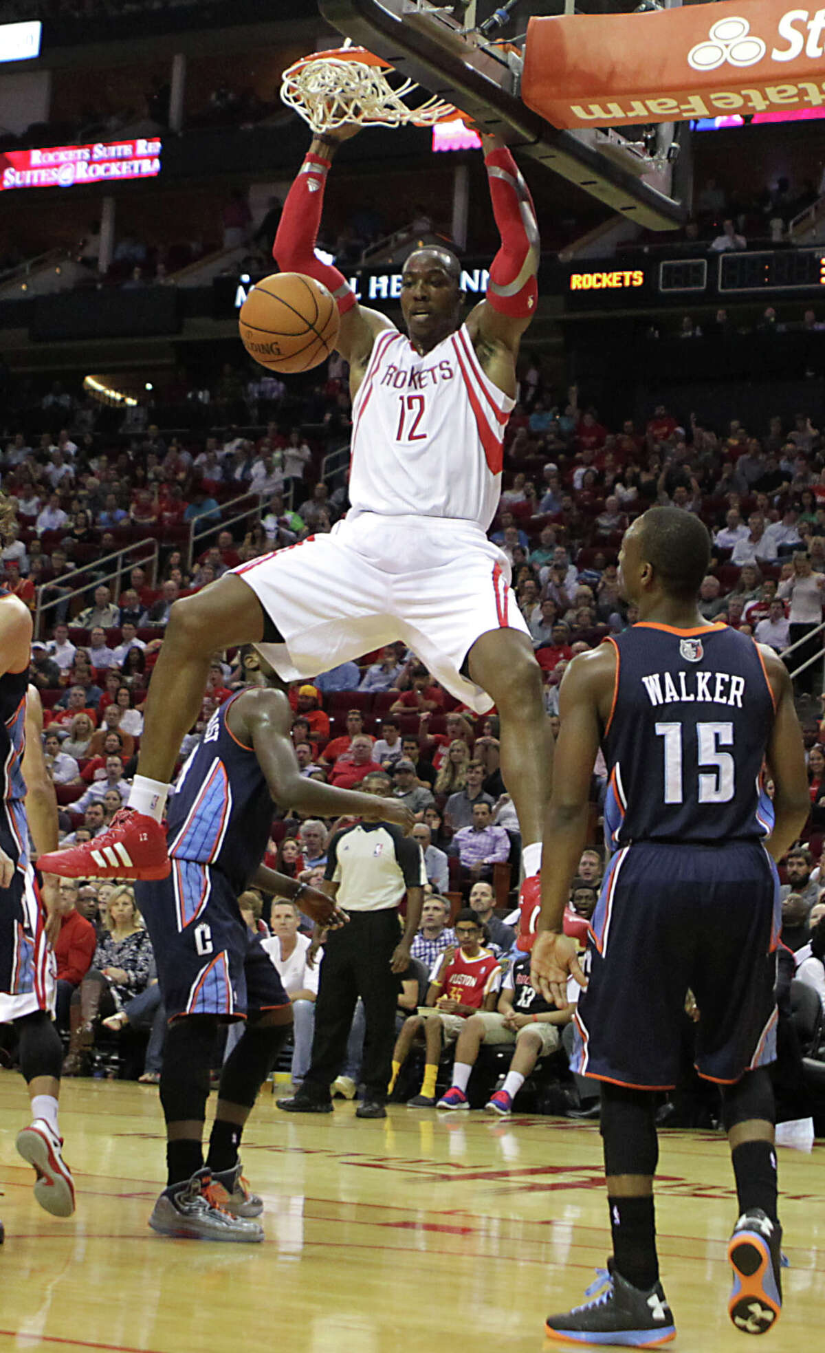 Dwight Howard slams home two of his 17 points Wednesday night, part of a Rockets debut that saw the NBA's most highly regarded center tie a career high with 26 rebounds in a 96-83 win over the Charlotte Bobcats at Toyota Center.