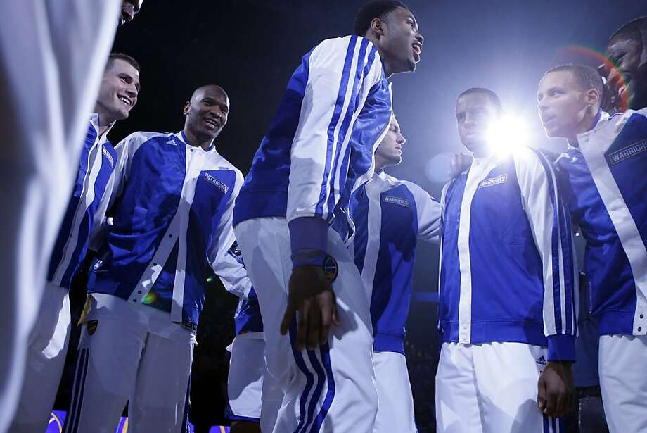 Warriors players get pumped up as they are introduced before the start of the game as the Golden State Warriors open their season against the Los Angeles Lakers at Oracle Arena in Oakland, CA Wednesday, October 30, 2013. Photo: Michael Short, The Chronicle