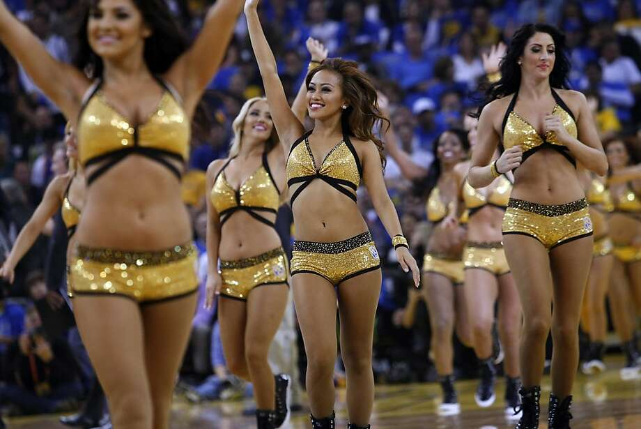 The Warriors Girls take the court during a break in the first half as the Golden State Warriors open their season against the Los Angeles Lakers at Oracle Arena in Oakland, CA Wednesday, October 30, 2013. Photo: Michael Short, The Chronicle