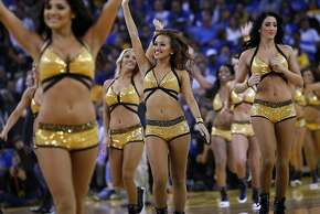 The Warrior's Girls take the court during a break in the first half as the Golden State Warriors open their season against the Los Angeles Lakers at Oracle Arena in Oakland, CA Wednesday, October 30, 2013.