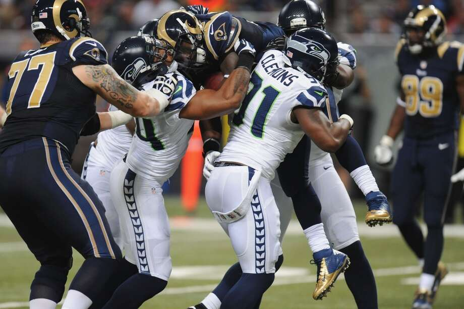 """Q: A lot of the guys on defense said they were tired after the Rams game; they were on the field for over 38 minutes, after all. Was conditioning an issue?PC:""""No, I don't think that was the case at all. I think the fact that it was such an emotional finish had a lot to do with it. It's rare when a bunch of guys get that opportunity to stand up at the end of the game, and they expended every ounce that they had. I think that's really what we were talking about in the locker room afterwards -- I know Earl (Thomas) and Clem (Chris Clemons) and some of the guys, they had given it everything they had to get that finish, to come through.   """"That's a very special moment for a group of guys out there. you don't get that chance that many times to have to stand up against it, play after play after play, and then get the win like you want to -- and with exceptional effort and play. I think that was the expense that happened; I think it was the culmination of the whole game that occurred. We had 80 plays too, or something like that, on defense; that was a lot for us.   """"On the other side of the ball, the offense is really fresh, so we'll counter it that way."""" Photo: Michael Thomas, Getty Images"""
