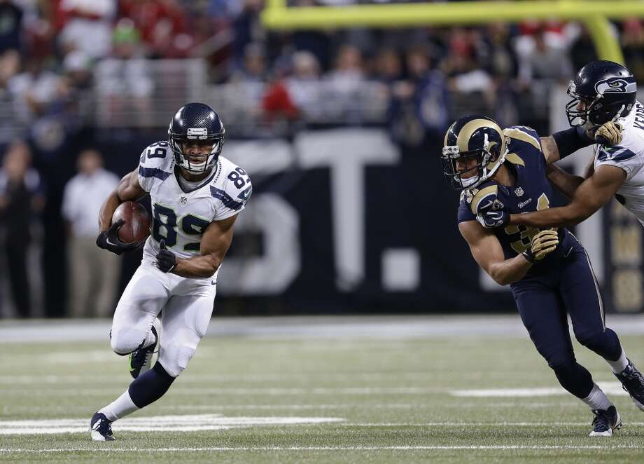 """Q: Wide receiver Doug Baldwin (pictured at left) has been targeted just twice in the past two games. How can you get the ball to him more?  PC: """"Just play ball. Play ball. It was nothing by design, it just happened that way. We love what he does. We'll get it to him by throwing it to him -- that's the answer to your question: 'by throwing it to him' -- but he's in the offense and he'll be a big part. He'll have more opportunity with Sidney not being in there now. We're excited to see him start in a game and play, and (seeing) Jermaine (Kearse) play a bunch and all of the guys add to it."""" Photo: Michael Conroy, Associated Press"""