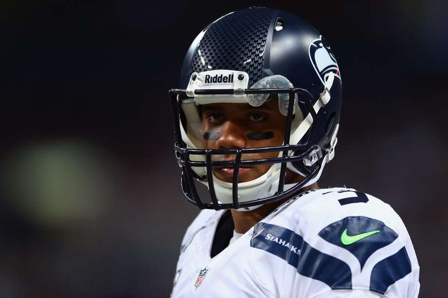 "Q: Russell Wilson said after Monday's game that he had been able to 'surrender' on extended plays. Can you explain what that means?  PC: ""Yeah, I understand that that was kind of taken differently. I thought he said it exactly right. What we tried to grab hold of last week is that there are opportunities for him to take care of the football first. And if he could recognize that by the nature of the rush and the situation that he was in, we were going to try to do a better job of that. He did a great job of that -- more so than the week before, he was rushed and had opportunity to where he could have gotten in trouble with the football.   ""The key to us winning that football game is that he did that, and we didn't give the ball up -- as vulnerable as we allowed that to happen and make him. The point is that he just was more conscious of putting the ball away and making sure he finished that play with the ball not getting out. That's all that meant. As opposed to maybe the ball being wild and he's spinning and running and getting hammered, I think he recognized the situations. We looked at every one of them. I think the first fear is, 'Oh boy, he's not going to try as hard to make the plays he's going to make.' That's not what he was talking about, and that's not what we understand about that at all. It was just how he put the ball away when the hits were happening. ..."" Photo: Andy Lyons, Getty Images"