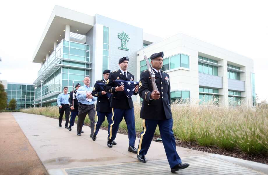 The U.S. Army Color Guard march to the flag raising ceremony at Newpark Drilling Fluids' new technology center, which hosted a grand opening on Wednesday, Oct. 30, 2013, in Katy. Photo: Mayra Beltran, Houston Chronicle