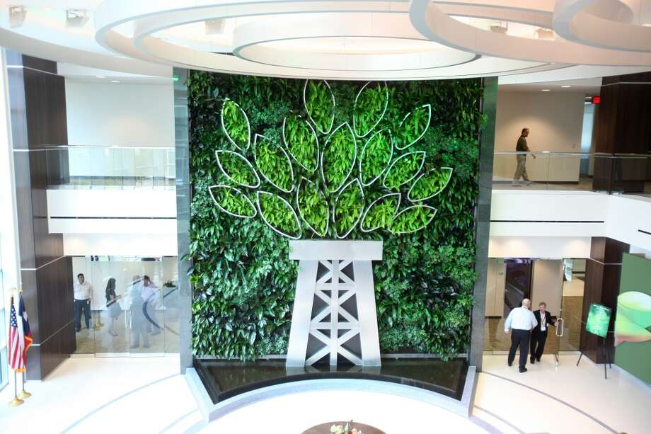 The living wall is the centerpiece in the lobby of Newpark Drilling Fluids' new technology center. Photo: Mayra Beltran, Houston Chronicle