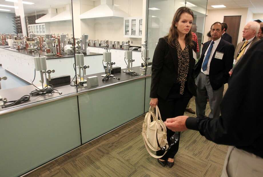 Rachel David, with U.S. Senator John Coryn's office, and other guests view a training lab during a tour of the Newpark Drilling Fluids' new technology center in Katy. Photo: Mayra Beltran, Houston Chronicle