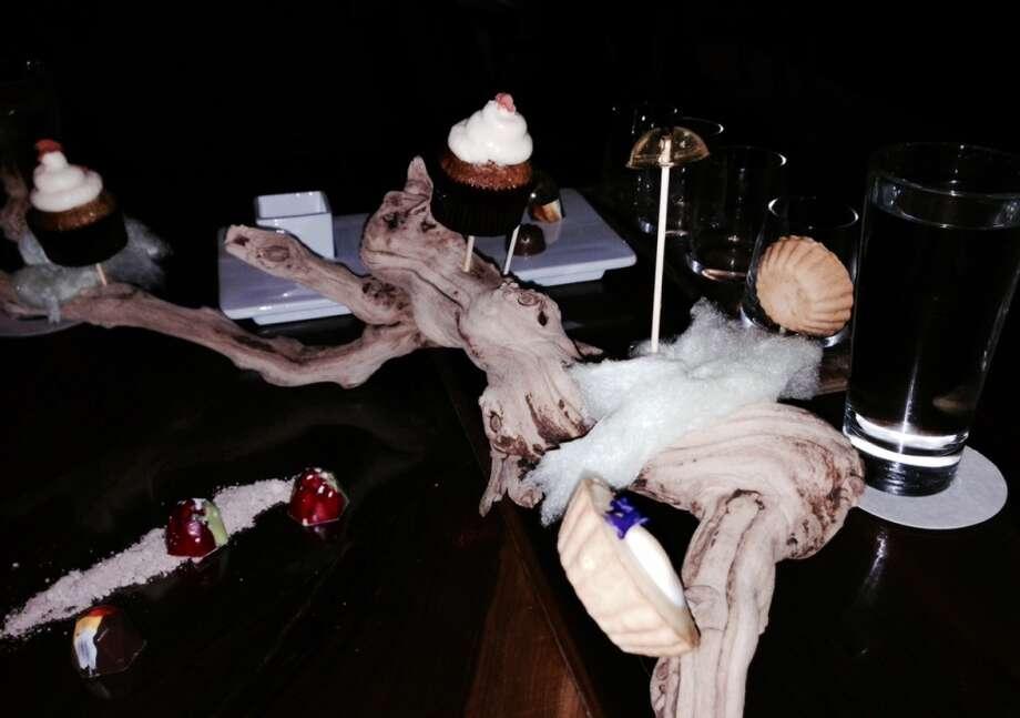 Desserts presented on a grape vine