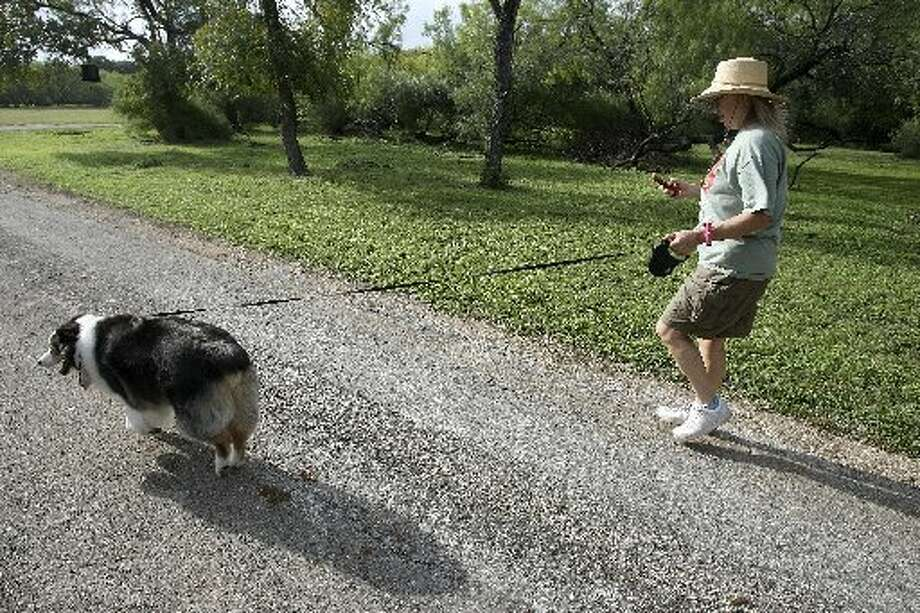 April Thomason walks her dog Quigly and takes photos of interesting things she sees along the way. Photo: Helen L. Montoya, San Antonio Express-News