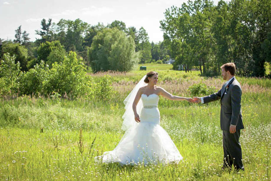 Christie (Abbott) Polley and Matt Polley were married on June 15, 2013. Photo: Photo: (c) Tom Wall Photography