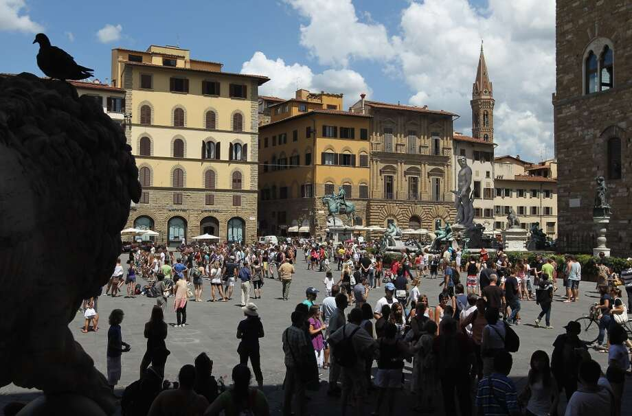 Florence, Italy | Aeroporto di Firenze (FLR)  Tourists crowd Piazza della Signora in Florence, which is among Italy's most popular tourist destinations. Photo: Sean Gallup, Getty Images