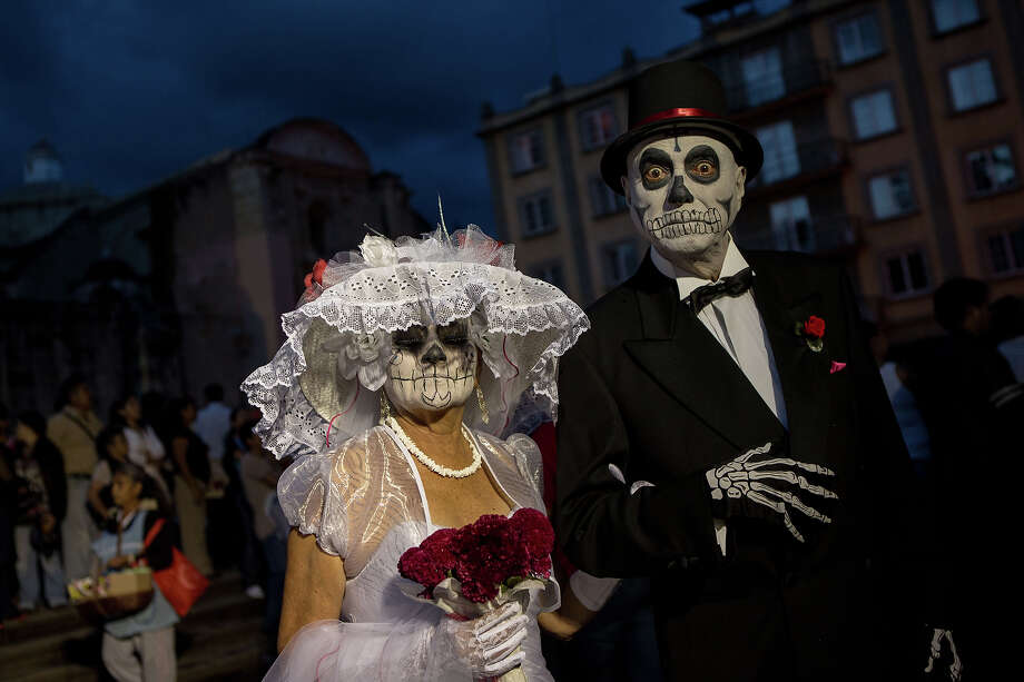 Revelers dance through the streets in traditional costumes at the start of the Day of the Dead festival known in Spanish as Dia de Muertos October 30, 2013 in Oaxaca, Mexico. Photo: Richard Ellis, Getty Images / 2013 Richard Ellis