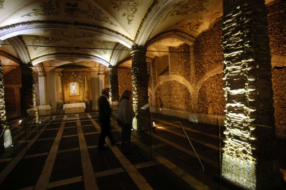 """Inside the 16th century Church of St. Francis in Evora, Portugal, is the """"Capela dos ossos"""" (Chapel of Bones), created by the monks supposedly from 5,000 corpses. Photo: Spud Hilton, The Chronicle"""