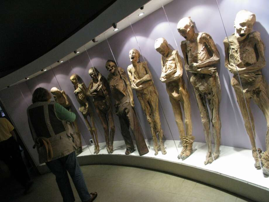 "El Museo De Las Momias (""The Mummies' Museum"") in Guanajuato, Mexico, offers not only a glimpse of what happens to bodies after death, but also what happens if your relatives don't keep up payments on your crypt. Photo: Spud Hilton, The Chronicle"