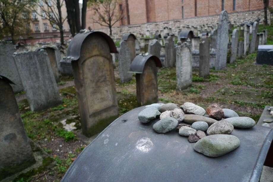 The cemetery in the Jewish Quarter of Krakow, Poland, is full of graves that had to be restored after German soldiers during World War II knocked down and broke most of the slabs. Photo: Spud Hilton, The Chronicle
