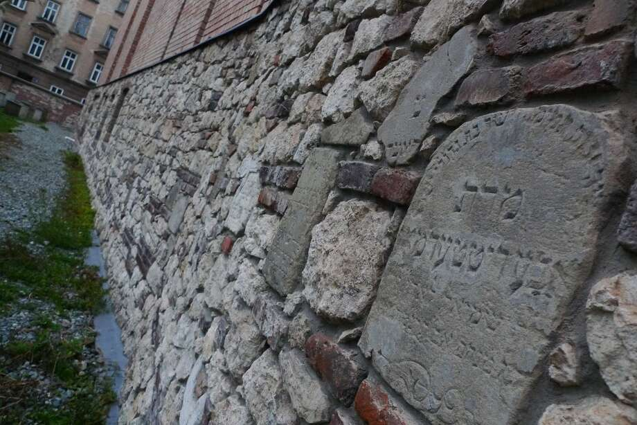 The cemetery now has a wall covered in large part by the pieces of broken tombstones. Photo: Spud Hilton, The Chronicle