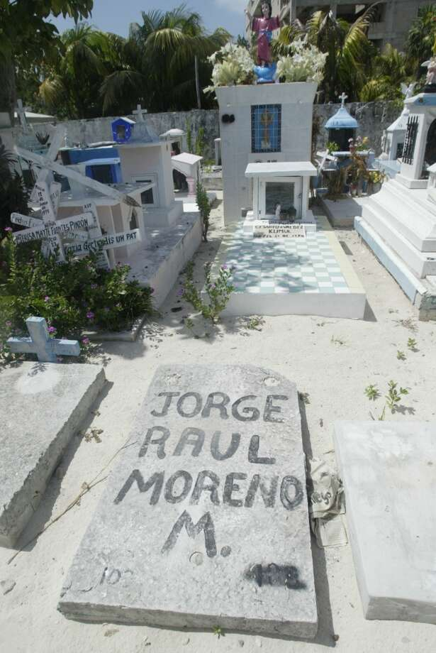 The graves run the range from elaborate monuments to a slab with the deceased's name hand-painted on it. The most famous grave is that of Mundaca the Pirate, who once owned most of the island, but he isn't actually buried there. Photo: Spud Hilton, The Chronicle