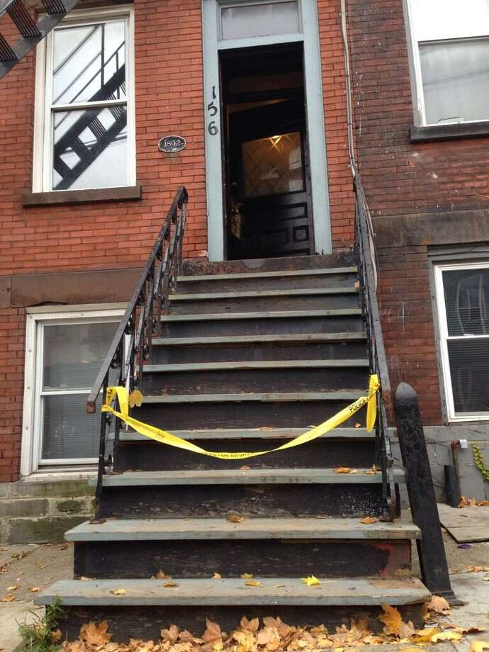 The scene outside 156 Lark St., Thursday morning, Oct. 31, 2013, where a woman was fatally shot early Thursday.  She died from a single gunshot wound. (Lori Van Buren/Times Union)