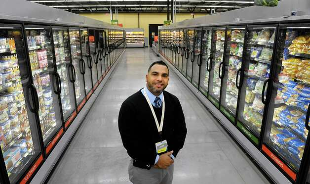 Store manager Juan Rivera stands in the frozen foods section at the Walmart Neighborhood Market on Thursday, Oct. 31, 2013 in Niskayuna, N.Y. (Paul Buckowski / Times Union) Photo: Paul Buckowski / 00024406A