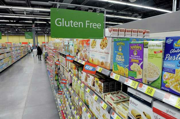A view of the gluten free section as workers finish stocking the shelves at the Walmart Neighborhood Market on Thursday, Oct. 31, 2013 in Niskayuna, N.Y.  (Paul Buckowski / Times Union) Photo: Paul Buckowski / 00024406A