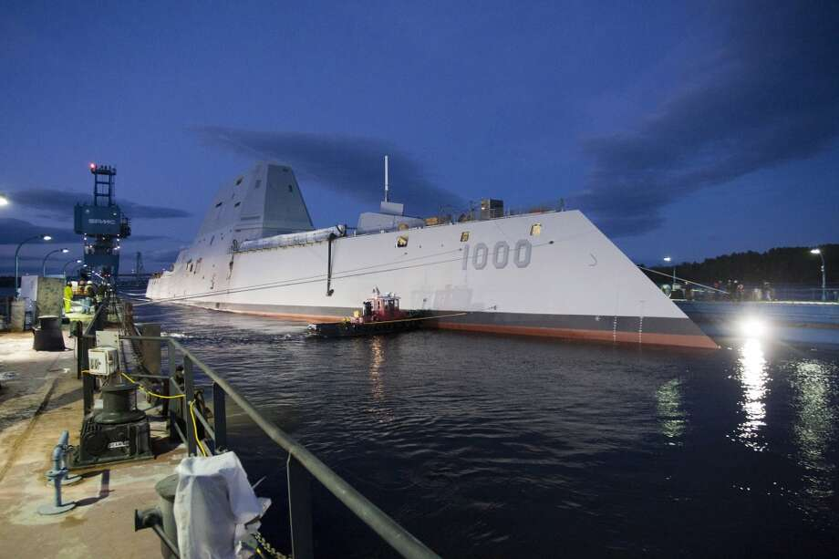 """The Zumwalt-class guided-missile destroyer DDG 1000 is floated out of dry dock at the General Dynamics Bath Iron Works shipyard. The ship, the first of three Zumwalt-class destroyers, will provide independent forward presence and deterrence, support special operations forces and operate as part of joint and combined expeditionary forces. The lead ship and class are named in honor of former Chief of Naval Operations Adm. Elmo R. """"Bud"""" Zumwalt Jr., who served as chief of naval operations from 1970-1974. Photo: General Dynamics, U.S. Navy"""