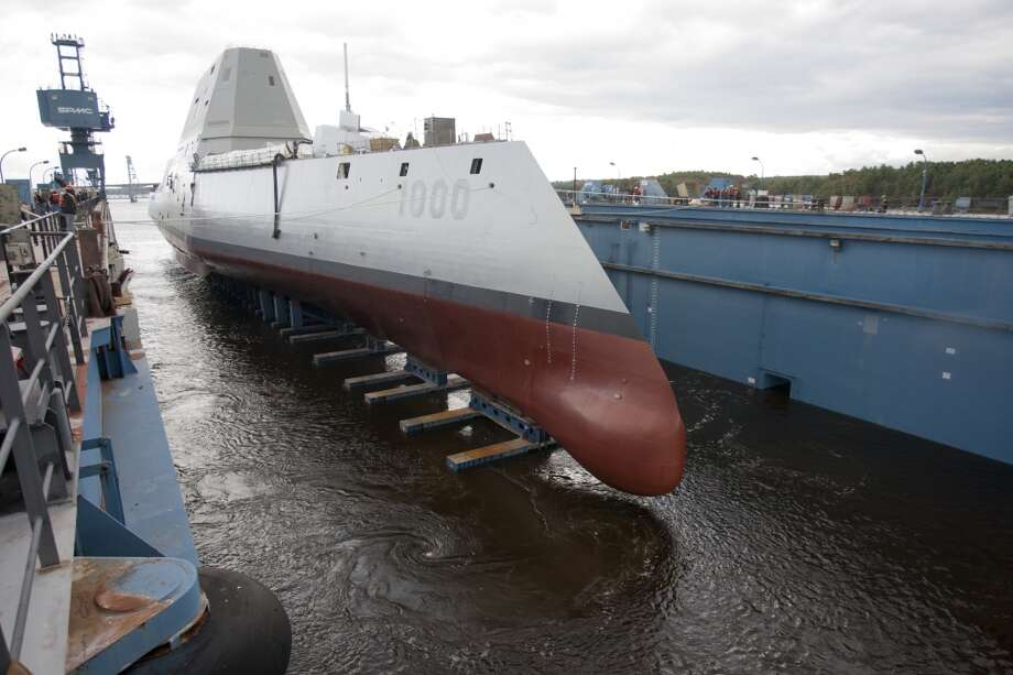 "The Zumwalt-class guided-missile destroyer DDG 1000 is floated out of dry dock at the General Dynamics Bath Iron Works shipyard. The ship, the first of three Zumwalt-class destroyers, will provide independent forward presence and deterrence, support special operations forces and operate as part of joint and combined expeditionary forces. The lead ship and class are named in honor of former Chief of Naval Operations Adm. Elmo R. ""Bud"" Zumwalt Jr., who served as chief of naval operations from 1970-1974. (U.S. Navy photo courtesy of General Dynamics/Released) Photo: General Dynamics, U.S. Navy"