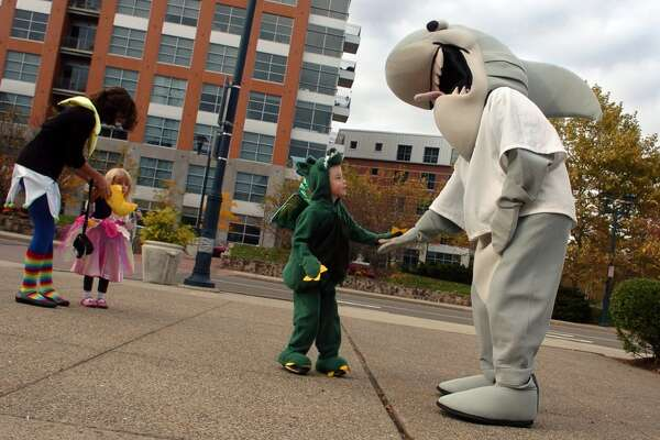 "Zachary Ayers, 4, of Bristol, greets the Maritime Aquarium shark in Norwalk, Conn., before going inside to attend the aquarium's ""Halloween Hoot"" celebration on Friday October 29, 2010."