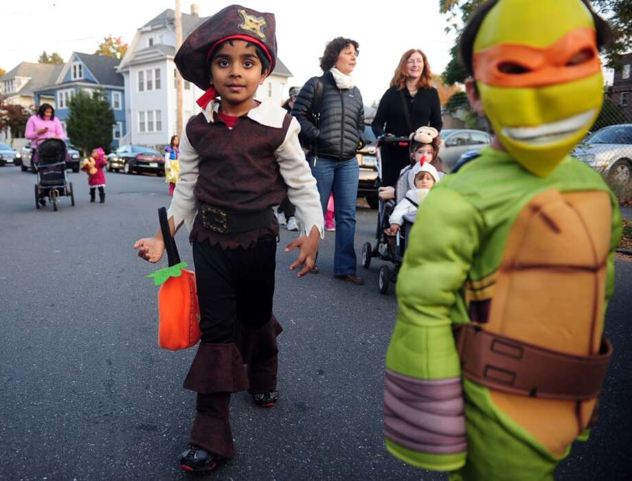 Trick or treat in groups and avoid breaking off alone, or letting others wander off alone.Source:CDC Photo: Autumn Driscoll