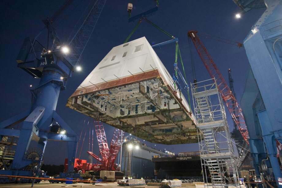 The 1,000-ton deckhouse of the future destroyer USS Zumwalt (DDG 1000) is craned toward the deck of the ship to be integrated with the ship's hull at General Dynamics Bath Iron Works. The ship launch and christening are planned in 2013. Photo: U.S. Navy Photo, U.S. Navy