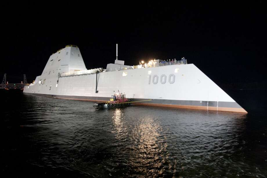 "The Zumwalt-class guided-missile destroyer DDG 1000 is floated out of dry dock at the General Dynamics Bath Iron Works shipyard. The ship, the first of three Zumwalt-class destroyers, will provide independent forward presence and deterrence, support special operations forces and operate as part of joint and combined expeditionary forces. The lead ship and class are named in honor of former Chief of Naval Operations Adm. Elmo R. ""Bud"" Zumwalt Jr., who served as chief of naval operations from 1970-1974. Photo: General Dynamics, U.S. Navy"