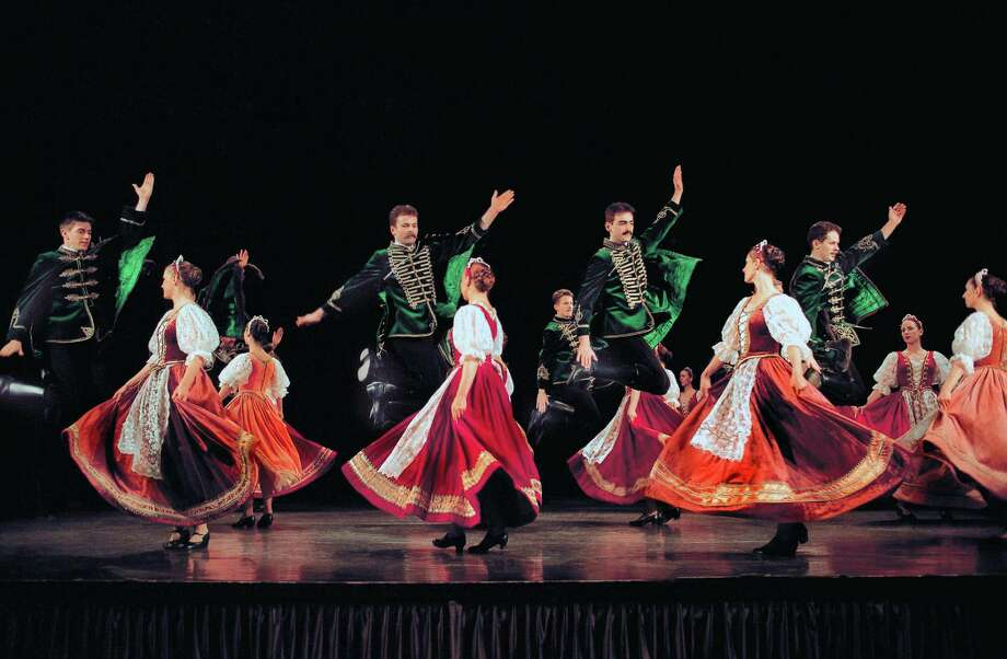 Members of the Hungarian State Folk Ensemble show some of the traditional moves during a previous performance. The group will come to Stamford, Conn., on Nov. 7, 2013, as part of a coast-to-coast tour of the United States. For more information, visit www.scalive.org. Photo courtesy of Columbia Artists Management Inc. Photo: Contributed Photo / Stamford Advocate Contributed