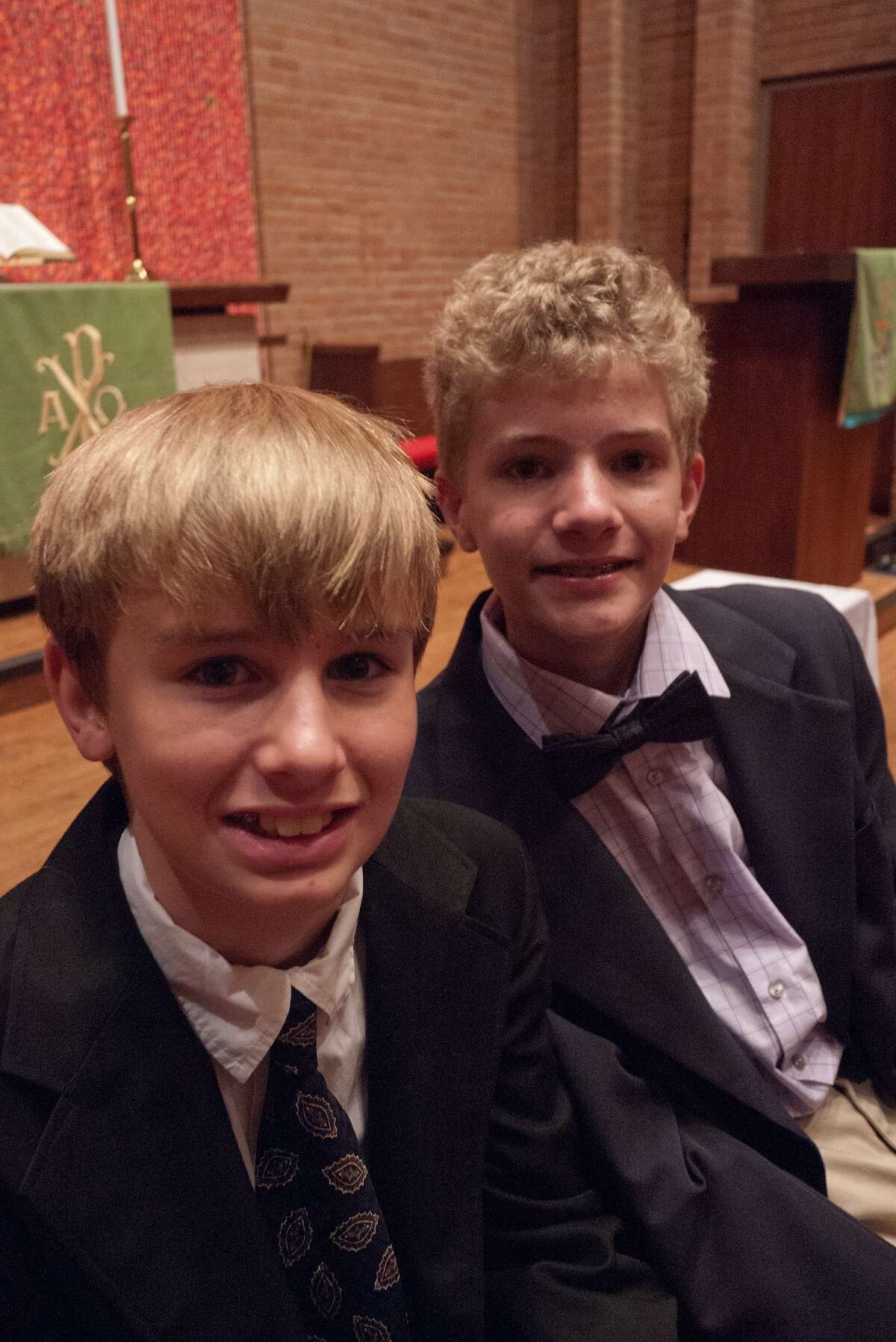 Jared Clark, 12, left, will run a triathlon to raise funds for trials into a rare disease affecting his twin brother, Justin.