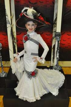 "This is a photo of my daughter Faythe Kelley. She is dressed as ""My Fair Lady"". The costume was made by her mother (Kim) and grandmother Nancy Collins. 