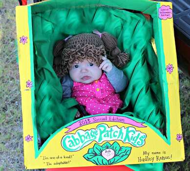 This year for Halloween my 2 1/2 month old daughter, Hadley, is a 2013 Special Halloween Edition Cabbage Patch Kid! :)