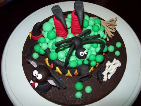 Halloween is here and while studying to be a Culinary Pastry Chef/Professor, I find myself working on a Halloween cake topper for a baby shower; made of fondant and gum paste and all edible. Happy Halloween to all Witches and Goblins, While hallowed saints around the world, dance around flickering flames, and dressed up little creatures go door to door for their treats; giving everyone a fright, and screaming Trick or Treat...Happy Halloween to all, for tonight we are all celebrating the Spirit of Halloween.