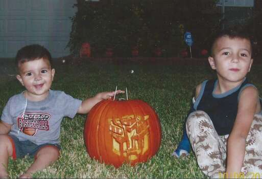 This was a carving that took me about 2-3 hrs. to carve out. It was so good when I placed it outside. It was stolen off our porch about an hour after I took this picture. Our 2 sons wanted Tranformers and as a parent I did as they requested. I was very disappointed that someone would steep that low as to steal a pumpkin carving. I bet some kid took it to a contest and won.