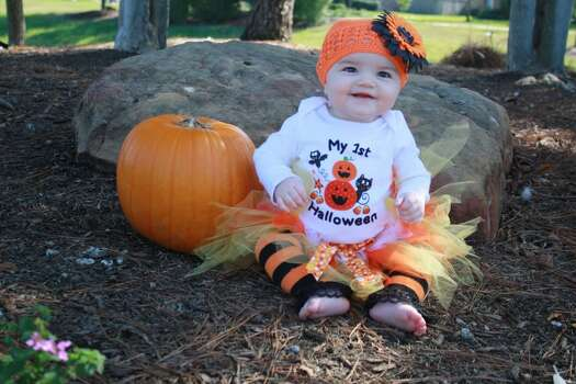 Gianna Veliz - 6 months old - Her first Halloween. Her leggings are made from adult knee high socks. Her tutu is handmade and her hat was put together by attaching a flower to the crochet beanie.