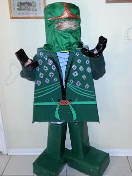 My Son Corey wanted to be The Green Ninja Lego Ninjago!! I put myself to work making him the perfect Costume and he LOVES It!