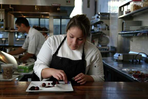 Samantha Mendoza, pastry chef at Triniti restaurant, creates one of her desserts, Thursday, Oct. 17, 2013, in Houston. ( Karen Warren / Houston Chronicle )