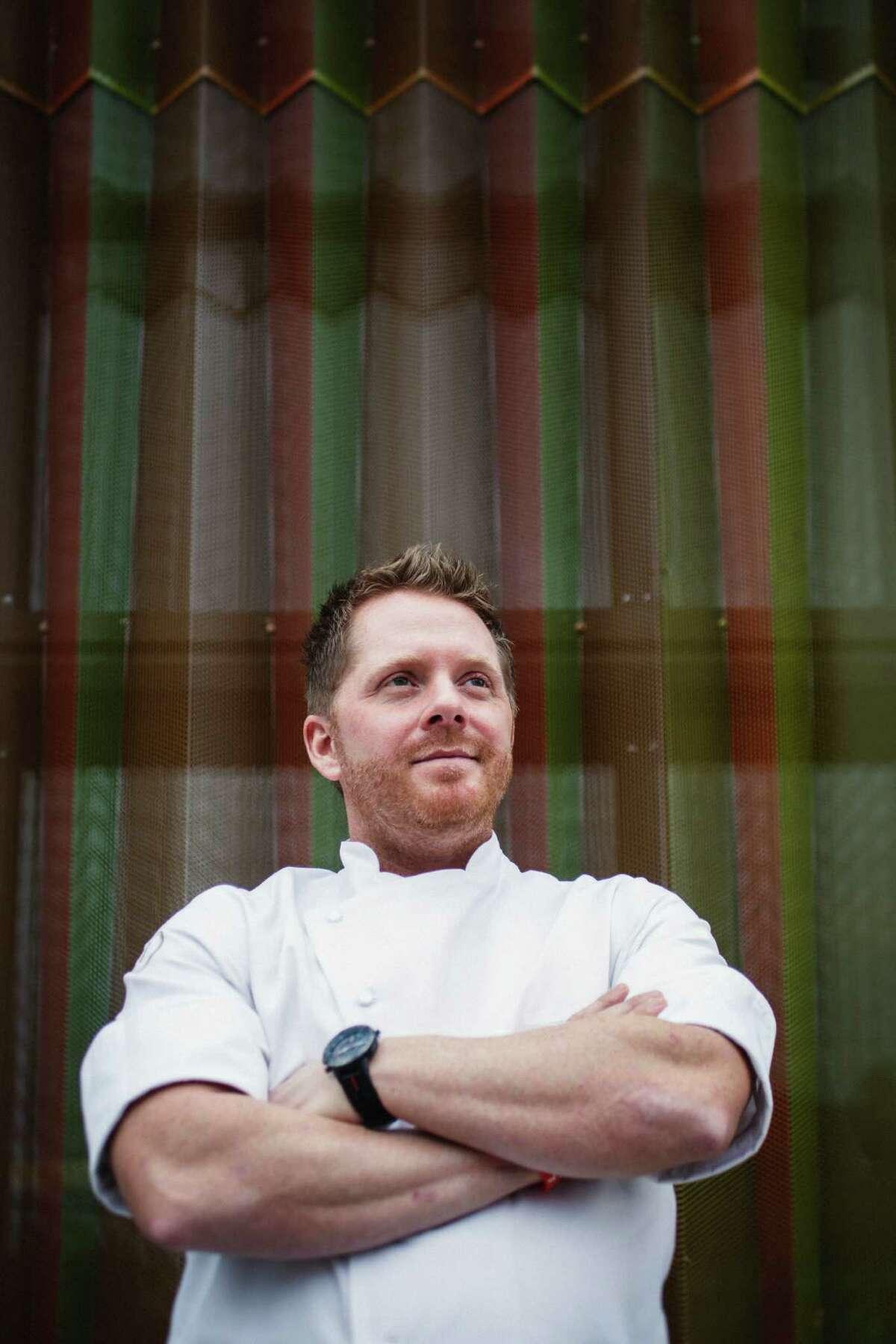 Chef Ryan Hildebrand poses for a photo at his restaurant, Triniti.