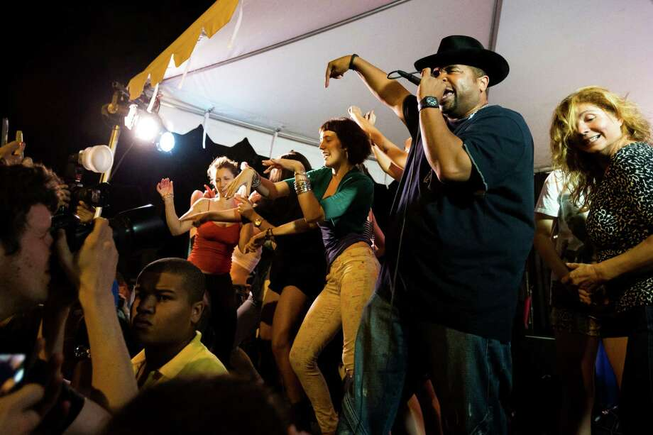 "Sir Mix-a-Lot performs ""Baby Got Back"" with a team of dancing female crowd recruits during the Dick's Drive-In 60th Anniversary Broadway Block Party Sunday, September 8, 2013, in the Capitol Hill neighborhood of Seattle. The all-day event boasted beers from a number of brewers and a host of live, local music. (Jordan Stead, seattlepi.com) Photo: JORDAN STEAD, Jordan Stead/seattlepi.com / SEATTLEPI.COM"